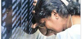 Mother of a valiant soldier of Sri Lankan security forces weeps at the war hero's memorial in Colombo, Sri Lanka during the ceremony to mark the successful conclusion of war with LTTE Tamil Terrorists on May 19, 2009