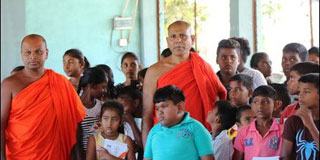 Buddhists monks are in North to support flood victims