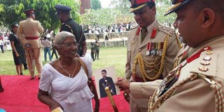 Families of Lankan soldiers missing in action still hope they'll return   The featured image  shows Maj. Athula's mother showing his picture to the officers of VIR